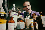Dr Lee Cantrell, who helps run the California Poison Control System, in his office with a collection of vintage expired medications, at the University of California San Diego Hospital in San Diego, CA on FRiday, July 7, 2017.(Photo by Sandy Huffaker for ProPublica)