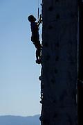 Chris Wang, 10, of Fremont climbs a rock climbing wall during Santa Clara County Parks Day on the Bay event at Alviso Marina County Park in Alviso, California, on October 13, 2013. (Stan Olszewski/SOSKIphoto)