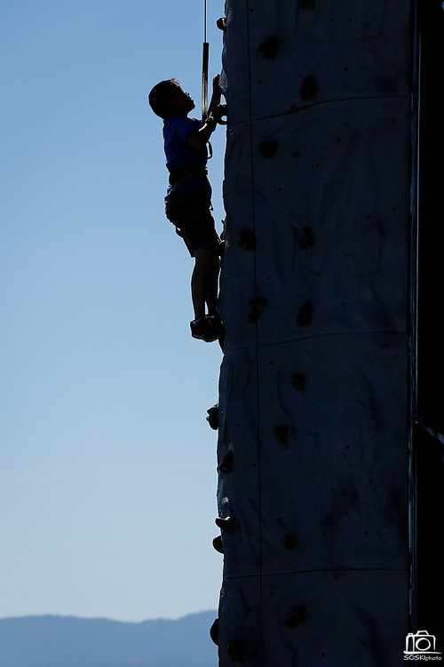 Chris Wang, 10, of Fremont climbs a rock climbing wall during Santa Clara County Parks Day on the Bay event at Alviso Marina County Park in Alviso, California, on October 13, 2013. (Stan Olszewski/SOSKIphoto)