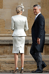 Robbie Williams arrives with his wife Ayda Field to attend the wedding for the wedding of Princess Eugenie to Jack Brooksbank at St George's Chapel in Windsor Castle.