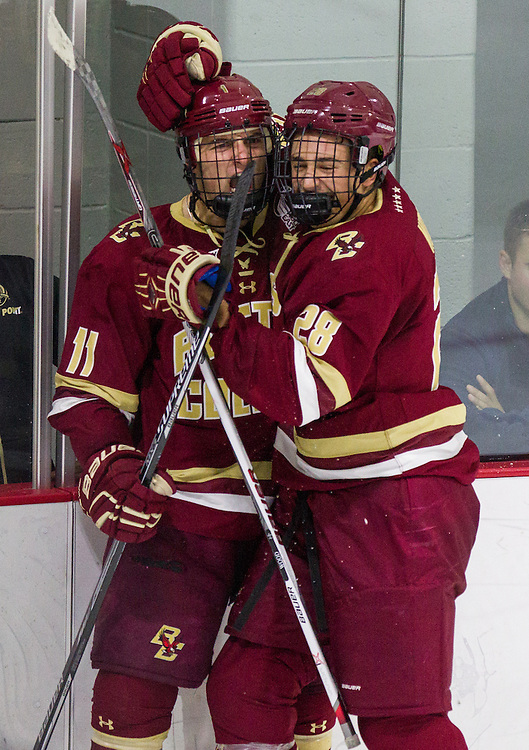 Boston College Forward Miles Wood (28) and Forward Chris Calnan (11) celebrate Calnan's goal during the second period of a NCAA hockey game between Army and Boston College at Tate Rink on October 9, 2015 in West Point, New York. (Dustin Satloff)