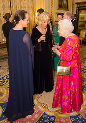 Queen Elizabeth II with the Duchess of Cornwall (centre) and Princess Zahra Aga Khan (left) in the White Drawing Room at Windsor Castle, during a reception before a private dinner to mark the diamond jubilee of the Aga Khan's leadership as Imam of the Shia Ismaili Muslim Community.