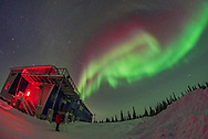 A reasonably bright display of Northern Lights appears and performs for the first aurora group of the season at the Churchill Northern Studies Centre, Churchill, Manitoba, on the night of February 11/12, 2018. The Kp Index was still low, only 0 to 1, and the Bz was often still North, but for some reason we got a decent display this night. Everyone was happy!<br /> <br /> This is a single shot with the Rokinon 12mm lens and Nikon D750.