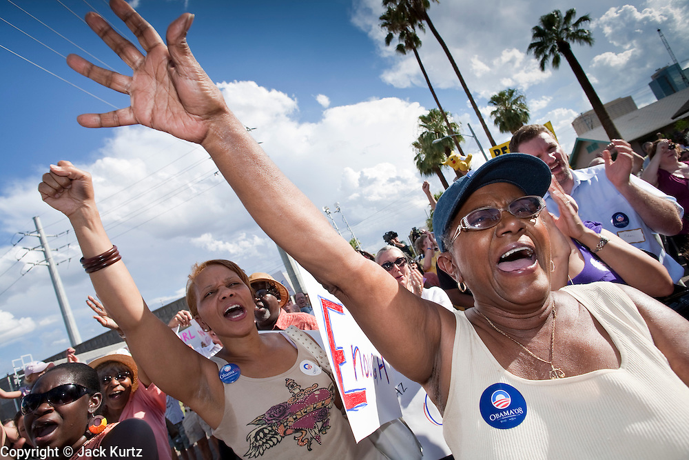 Sept. 10, 2008 -- PHOENIX, AZ: People chant for Barack Obama at the opening of the Obama office in Phoenix Wednesday. The Barack Obama presidential campaign opened an office in Phoenix Wednesday just five miles from the home of Republican presidential candidate John McCain. About 400 Obama supporters came the opening.   Photo by Jack Kurtz