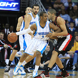 02 February 2009:  New Orleans Hornets guard Chris Paul (3) drives past Portland Trailblazers guard Martell Webster (8) during a 97-89 loss by the New Orleans Hornets to the Portland Trail Blazers at the New Orleans Arena in New Orleans, LA.