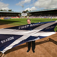 St Johnstone v Motherwell...15.08.09 <br /> St Johnstone Chairman Geoff Brown (centre) struggles to unveil the 1st Division Champions Flag in the wind before kick off<br /> Picture by Graeme Hart.<br /> Copyright Perthshire Picture Agency<br /> Tel: 01738 623350  Mobile: 07990 594431