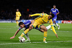 Andre Carrillo of Sporting is challenged by Cesar Azpilicueta of Chelsea - Photo mandatory by-line: Rogan Thomson/JMP - 07966 386802 - 10/12/2014 - SPORT - FOOTBALL - London, England - Stamford Bridge - Sporting Clube de Portugal - UEFA Champions League Group G.