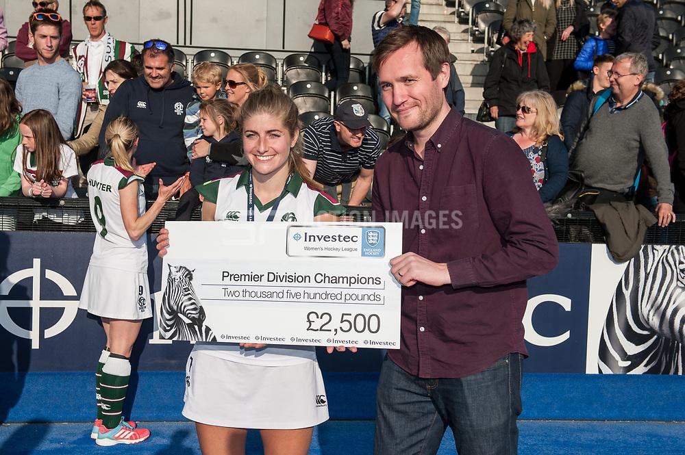 Surbiton's Sarah Haycroft receives the winners cheque. Holcombe v Surbiton - Investec Women's Hockey League Final, Lee Valley Hockey & Tennis Centre, London, UK on 23 April 2017. Photo: Simon Parker