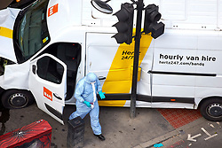 **PREVIOUSLY UNSEEN PICTURES** <br /> &copy; Licensed to London News Pictures. 04/06/2017. LONDON, UK.  Forensic officers examine the white van, including objects that may be petrol bombs, used by Khuram Butt, Rachid Redouane and Youssef Zaghba to murder at least eight people on London Bridge and in nearby Borough Market the day after the attack unfolded. Photo credit: Cliff Hide/LNP
