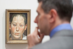 © Licensed to London News Pictures. 08/02/2012. LONDON, UK. .An art fan stands in front of Lucian Frued's 'Frances Costelloe' at an exhibition taking place at the National Portrait Gallery in London. .The exhibition entitled Lucian Frued Portraits, due to open on the 9th of February 2012, represents one of the largest collections the late artists work ever assembled with over 100 paintings, drawings and etchings on display. Photo credit: Matt Cetti-Roberts/LNP