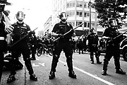 Seattle Police form a barricade to block the counter-protest march from reaching the Freedom Rally at Westlake Park. Seattle, WA. August 13, 2017.