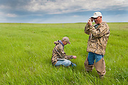 Ducks Unlimited biologists at work, candling egg, Goebel Ranch, McPherson County, South Dakota
