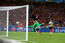 LILLE, FRANCE - Friday, July 1, 2016: Wales' Sam Vokes scores the third goal against Belgium's Thibaut Courtois, to make the score 3-1, during the UEFA Euro 2016 Championship Quarter-Final match against Belgium at the Stade Pierre Mauroy. (Pic by Paul Greenwood/Propaganda)