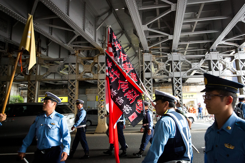 "TOKYO, JAPAN - JULY 16: Japanese nationalists holding flags took to the streets in a ""hate demonstration"" in Akihabara, Tokyo, Japan on July 16, 2017. The nationalists faced off with anti-racist groups who mounted counter protests demanding an end to hate speech and racism in Japan. (Photo by Richard Atrero de Guzman/AFLO)"