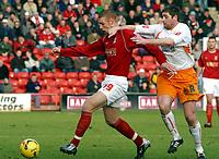 Photo: Dave Linney.<br />Walsall v Blackpool. Coca Cola League 1. 31/12/2005.<br />James Constable (Walsall)  keeps  John Doolan(Blackpool) at bay.