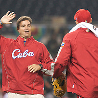16 March 2009: Cuban team doctor Antonio Castro congratulates a player after a win during the 2009 World Baseball Classic Pool 1 game 3 at Petco Park in San Diego, California, USA. Cuba wins 7-4 over Mexico.