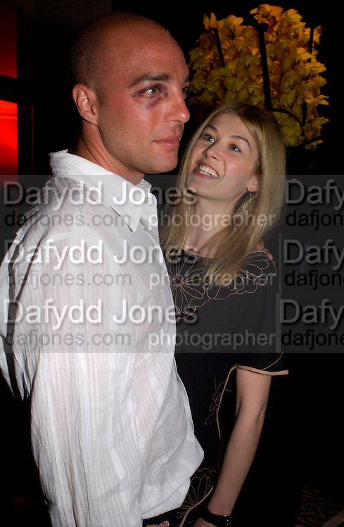 Rosamund Pike and her boyfriend, Kill Bill part 2. post premiere party. Old In and Out club. Piccadilly, 20 April 2004. ONE TIME USE ONLY - DO NOT ARCHIVE  © Copyright Photograph by Dafydd Jones 66 Stockwell Park Rd. London SW9 0DA Tel 020 7733 0108 www.dafjones.com