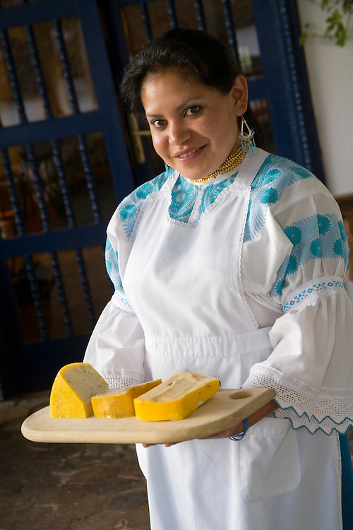 South America, Ecuador, Imbabura Province, Zuleta, waitress serving cheese made at Hacienda