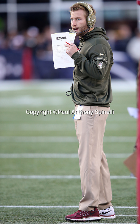 Washington Redskins offensive coordinator Sean McVay calls signals from the sideline during the 2015 week 9 regular season NFL football game against the New England Patriots on Sunday, Nov. 8, 2015 in Foxborough, Mass. The Patriots won the game 27-10. (©Paul Anthony Spinelli)