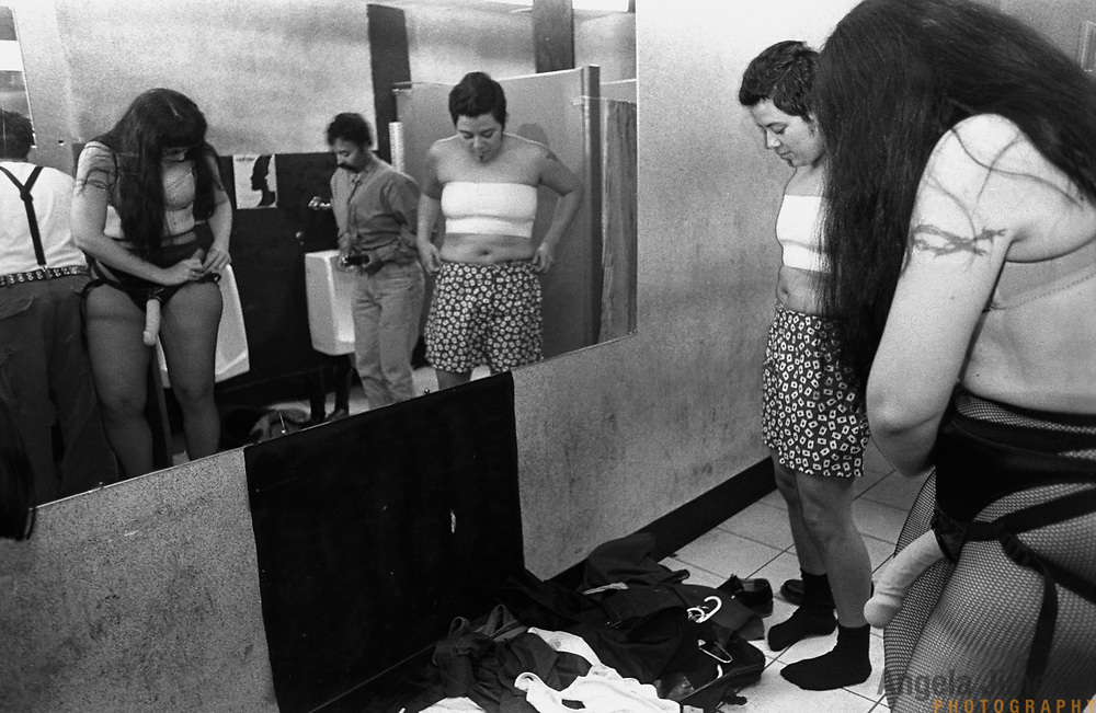 Amie M. Evans (aka &quot;Princess Amie&quot;), left as seen in mirror, and Talia Kingsbury (aka &quot;Manuel Hung&quot;), right as seen in mirror, of the Boston performance troupe The Princesses of Porn and the Dukes of Dykedom, dress in the bathroom before their performance at the 4th Annual International Drag King Extravaganza at the Millenium Nite Club in Columbus, Ohio on October 19, 2002. The conference consists of workshops and gender performances by biological and transgendered women performing as drag kings (dressed as men) and as femmes (dressed as feminine women).<br /> <br /> photo by Angela Jimenez for VelvetPark Magazine