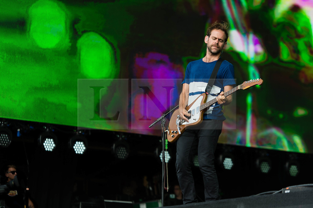 © Licensed to London News Pictures. 12/07/2014. London, UK.   The National performing live at Hyde Park as part of the British Summer Time series of outdoor concerts.  In this picture - Bryce Dessner. The National is an American indie rock band consisting of members Matt Berninger (lead vocals), Aaron Dessner (guitar, bass, piano, keyboards), Bryce Dessner (guitar, keyboards), Bryan Devendorf (drums), Scott Devendorf (bass, guitar, backing vocals).  Photo credit : Richard Isaac/LNP