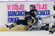 STOCKHOM 2017-10-18. Ludvig Claesson i AIK tacklas under matchen i Hockeyallsvenskan mellan AIK och IF Bj&ouml;rkl&ouml;ven p&aring; Hovet, Stockholm, den 18 oktober 2017.<br /> Foto: Nils Petter Nilsson/Ombrello<br /> ***BETALBILD***