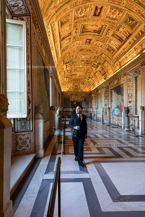 ROME, Vatican Museums, Gianni C, Giovanni Crea walking holding the Museum keys in the Gallery of the Maps
