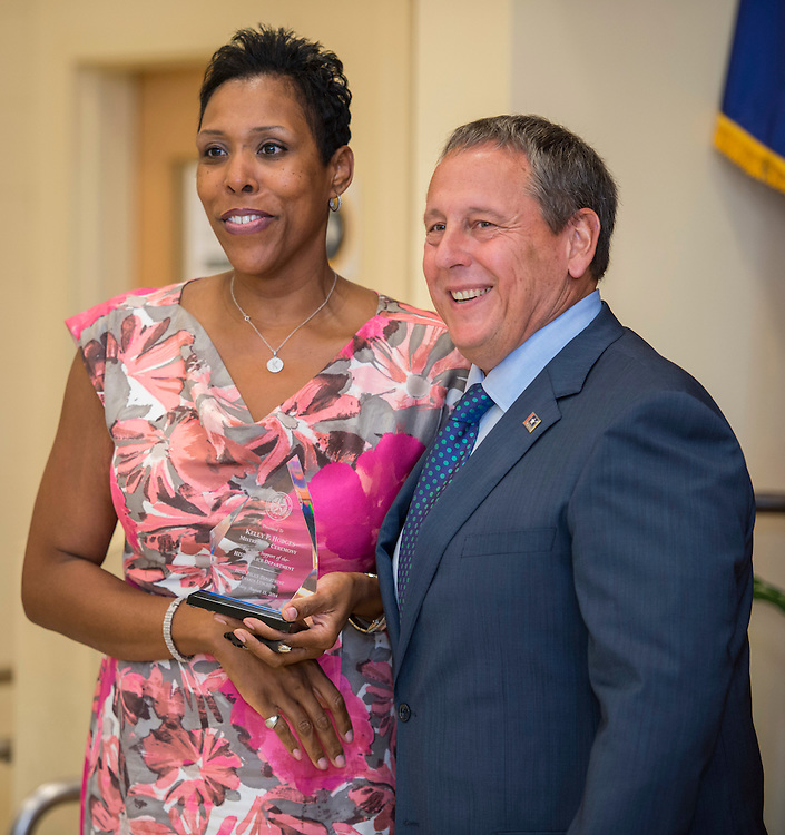 Chief Robert Mock, right, recognizes master of ceremony Kelly Hodges, left, during the Houston ISD Police awards banquet at Thompson Elementary School, August 15, 2014.