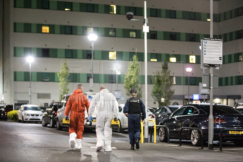 © Licensed to London News Pictures. 10/08/2017. Salford, UK. Forensic examiners enter a car park at the rear of the Ibis Hotel in Salford Quays where a young boy was killed in a collision with a car earlier this evening (Thursday 10th August 2017) . Photo credit: Joel Goodman/LNP