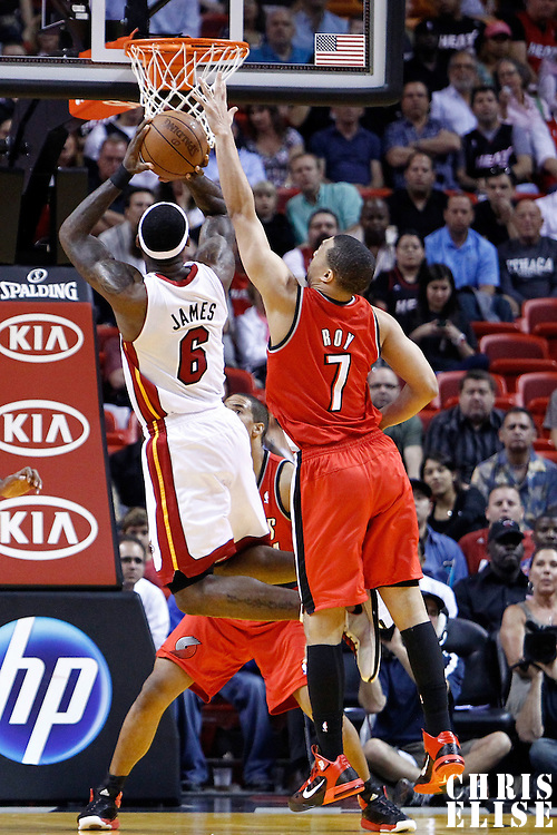08 March 2011: Miami Heat small forward LeBron James (6) takes a jumpshot over Portland Trail Blazers shooting guard Brandon Roy (7) during the Portland Trail Blazers 105-96 victory over the Miami Heat at the AmericanAirlines Arena, Miami, Florida, USA.