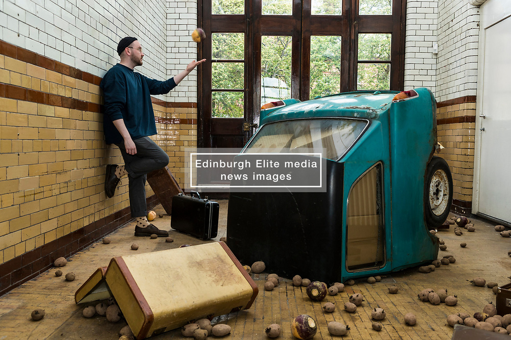 For nine days in June (1-9 June 2017), Edinburgh College of Art is transformed into vibrant gallery spaces exhibiting work from more than 500 graduating students at this year's Degree Show.<br /> <br /> For the first time, the former Fire Station on Lauriston Place – recently acquired by the University – will be used as part of Edinburgh College of Art's extensive exhibition. <br /> <br /> Work from 38 degree programmes will be on display – including architectural models, animated films, photography, textiles, jewellery and interior design.<br /> <br /> Sculpture student Michael Kay Terence's installations were inspired by the former Fire Station, where his work will be on show. The space features a bright turquoise Mini, which has been cut in half and crash-landed. <br /> <br /> Rachel McLellan has explored the themes of identity and tribalism by creating a giant web of brightly coloured T-shirts, emblazoned with slogans.<br /> <br /> Pictured: Michael Kay Terence inside his installation featuring the crash-landed mini