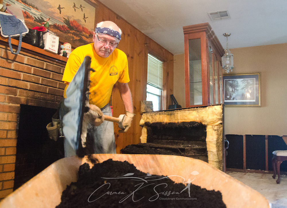 SBDR volunteer Roger Gatlin, a member of Pisgah Baptist Church in Excelsior Springs, Mo., shovels soot from Louisiana homeowner Fay McDowell's fireplace so it can be sprayed with a mold preventative, Aug. 22, 2016, in Baton Rouge, La. McDowell is one of thousands of Louisiana residents whose homes were damaged by floods last week. (Photo by Carmen K. Sisson)