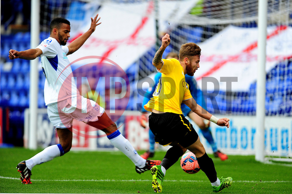 Bristol Rovers' Matty Taylor gets ashot away - Photo mandatory by-line: Neil Brookman/JMP - Mobile: 07966 386802 - 08/11/2014 - SPORT - Football - Birkenhead - Prenton Park - Tranmere Rovers v Bristol Rovers - FA Cup - Round One