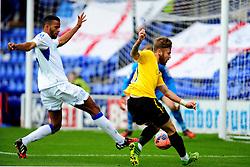 Bristol Rovers' Matty Taylor gets ashot away - Photo mandatory by-line: Neil Brookman/JMP - Mobile: 07966 386802 - 08/11/2014 - SPORT - Football - Birkenhead - Prenton Park - Tranmere Rovers v Bristol Rovers - FA Cup - Round One
