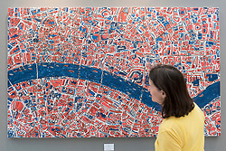 "© Licensed to London News Pictures. 20/06/2018. LONDON, UK. A visitor views ""London, Red, Terracotta, Royal Blue"", 2018, by Barbara Macfarlane, a map of the River Thames flowing through central London, at The Art & Antiques Fair Olympia which runs 20 to 27 June at Kensington Olympia.  Photo credit: Stephen Chung/LNP"