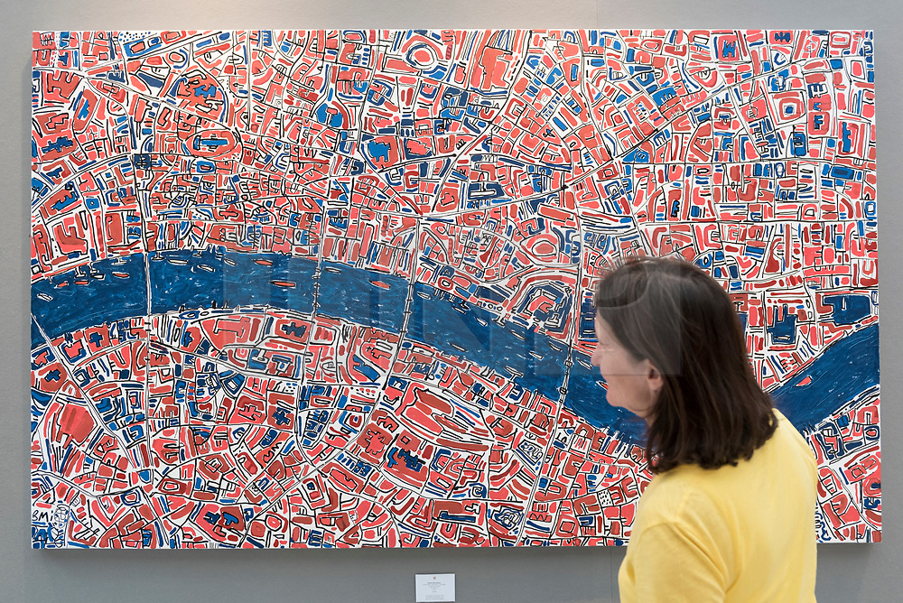 """© Licensed to London News Pictures. 20/06/2018. LONDON, UK. A visitor views """"London, Red, Terracotta, Royal Blue"""", 2018, by Barbara Macfarlane, a map of the River Thames flowing through central London, at The Art & Antiques Fair Olympia which runs 20 to 27 June at Kensington Olympia.  Photo credit: Stephen Chung/LNP"""