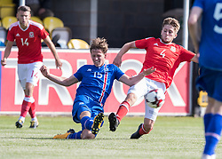 RHYL, WALES - Saturday, September 2, 2017: Wales' Ryan Reynolds in action against Alex Por Hauksson of Iceland during an Under-19 international friendly match between Wales and Iceland at Belle Vue. (Pic by Gavin Trafford/Propaganda)