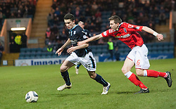 Dundee's Alex Harris and Ross County's Steven Saunders. <br /> Dundee 1 v 1 Ross County, SPFL Premiership game player 4/1/2015 at Dundee's home ground Dens Park.