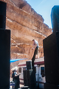 Man on roof of trailer at Middle East Tek, Wadi Rum, Jordan, 2008