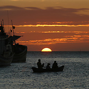 """Sunset off the coast of Vung Tau, Vietnam, a popular beach resort a few hours' drive from Ho Chi Minh City. Former glam rock star Gary Glitter is currently behind bars in the resort town, facing charges of child molestation. Glitter, whose real name is Paul Gadd, was convicted in Britain in 1999 of possessing child pornography and served two months in jail. In 2002 he was kicked out of Cambodia, a country with lax regulation of prostitution. Glitter's 1970's hit """"Rock and Roll (Part 2)""""  is played regularly at sporting events throughout North America and Europe."""