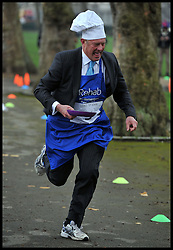 Lord St John of Bletso takes part in the MP's and Lords race against political Journalist in the Rehab Parliamentary Pancake Shrove Tuesday race a charity event which sees MPs and Lords joined by media types in a race to the finish. Victoria Tower Gardens, Westminster, Tuesday February 12, 2013. Photo By Andrew Parsons / i-Images
