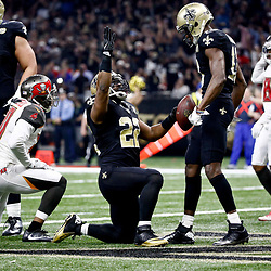Dec 24, 2016; New Orleans, LA, USA; New Orleans Saints running back Mark Ingram (22) celebrates with wide receiver Michael Thomas (13) during the first quarter of a game against the Tampa Bay Buccaneers at the Mercedes-Benz Superdome. Mandatory Credit: Derick E. Hingle-USA TODAY Sports