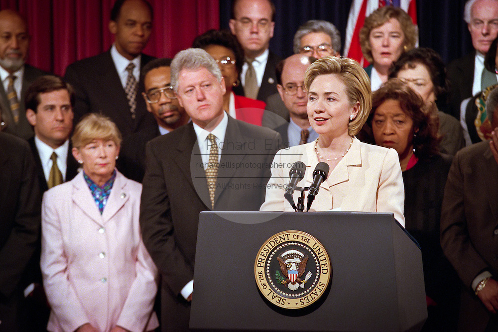 First lady Hillary Clinton along with husband President Bill Clinton during an event to promote his proposals to help stop gun related killings like those at Columbine High School during an event along with members of Congress at the White House April 27, 1999 in Washington, DC