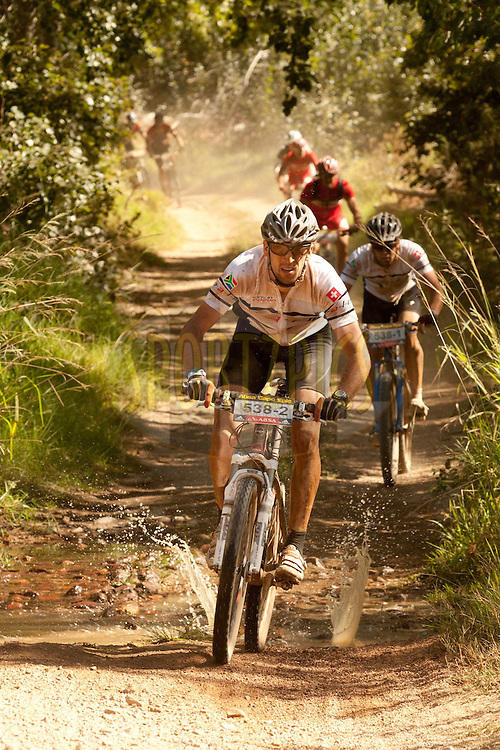 Splish splash. A small stream crossing is one of very few places fo watyer during a tough hot stage 1 of the 2011 Absa Cape Epic Mountain Bike stage race held from Saronsberg Wine Estate in Tulbagh, South Africa on the 28 March 2011..Photo by Greg Beadle/Cape Epic/SPORTZPICS