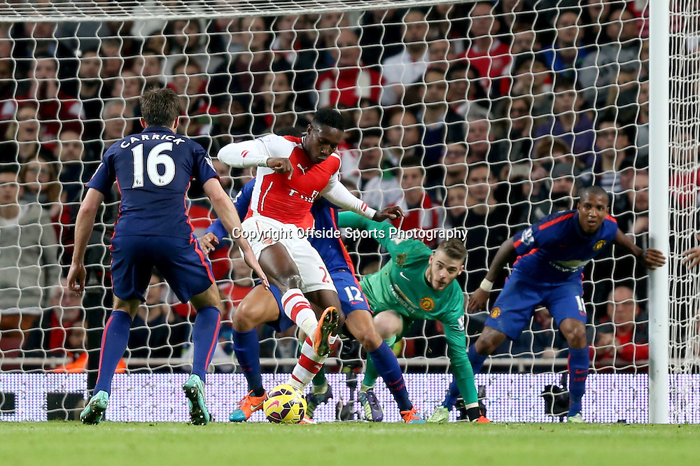 22 November 2014 - Barclays Premier League - Arsenal v Manchester United - Danny Welbeck of Arsenal tries to back heel the ball past Manchester United goalkeeper, David de Gea - Photo: Marc Atkins / Offside.
