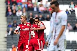 GOAL CELEBRATIONS. Bristol City captain, Sam Baldock celebrates his goal with team mates.  - Photo mandatory by-line: Dougie Allward/JMP - Tel: Mobile: 07966 386802 24/08/2013 - SPORT - FOOTBALL - Stadium MK - Milton Keynes -  Milton Keynes Dons V Bristol City - Sky Bet League One