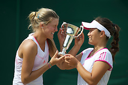 LONDON, ENGLAND - Sunday, July 3, 2011: Eugenie Bouchard (CAN) and Grace Min (USA) celebrate with the trophy after winning the Girls' Doubles Final match on day thirteen of the Wimbledon Lawn Tennis Championships at the All England Lawn Tennis and Croquet Club. (Pic by David Rawcliffe/Propaganda)
