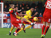 Crawley Town midfielder Simon Walton passes forward under pressuree from Bristol Rovers midfielder Stuart Sinclair during the Sky Bet League 2 match between Crawley Town and Bristol Rovers at the Checkatrade.com Stadium, Crawley, England on 21 November 2015. Photo by Bennett Dean.