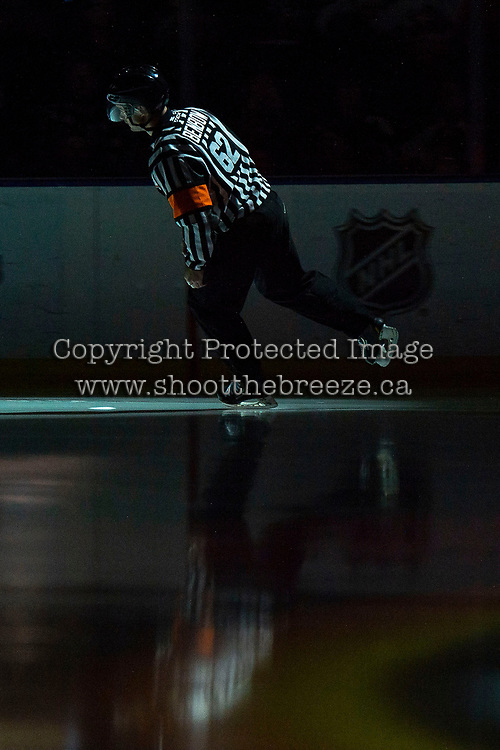 KELOWNA, BC - OCTOBER 12: Referee Ryan Benbow skates onto the ice at the Kelowna Rockets against the Kamloops Blazers at Prospera Place on October 12, 2019 in Kelowna, Canada. (Photo by Marissa Baecker/Shoot the Breeze)