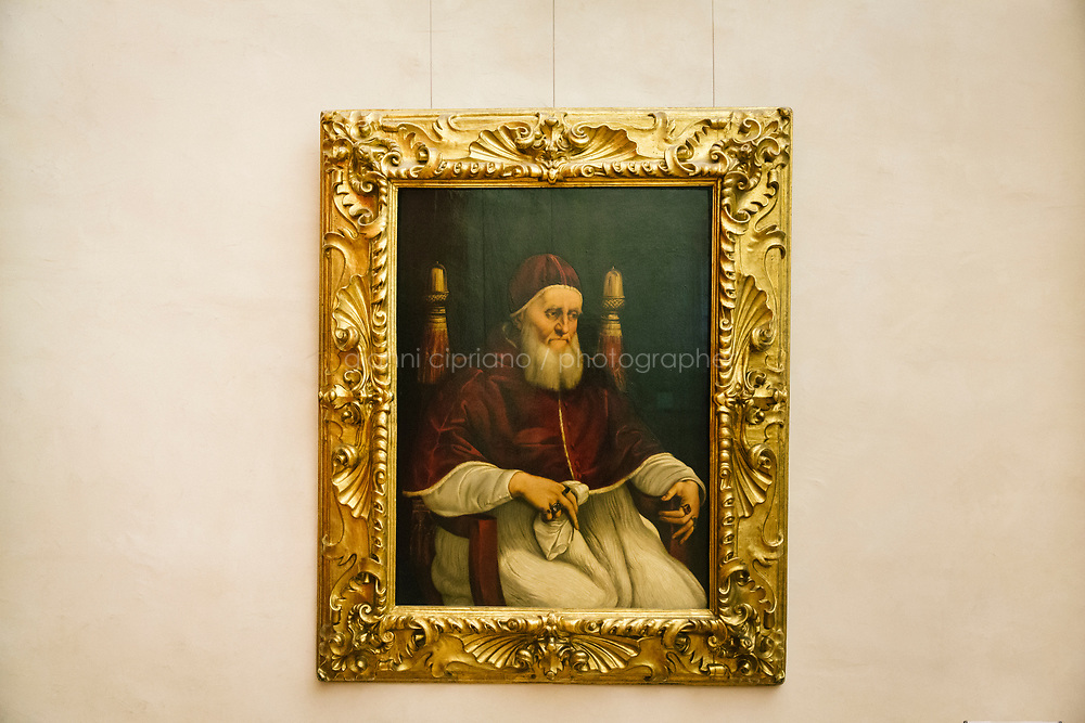 FLORENCE, ITALY - 3 JUNE 2018: &quot;Portrait of Pope Julius II&quot; (1511-1512 ca) by Raphael is seen here at the Uffizi before being relocated at Palazzo Pitti, in Florence, Italy, on June 3rd 2018.<br /> <br /> As of Monday June 4th 2018, Room 41 or the &ldquo;Raphael and Michelangelo room&rdquo; of the Uffizi is part of the rearrangement of the museum's collection that has<br /> been defining Uffizi Director Eike Schmidt&rsquo;s grander vision for the Florentine museum.<br /> Next month, the museum&rsquo;s Leonardo three paintings will be installed in a<br /> nearby room. Together, these artists capture &ldquo;a magic moment in the<br /> first decade of the 16th century when Florence was the cultural and<br /> artistic center of the world,&rdquo; Mr. Schmidt said. Room 41 hosts, among other paintings, the dual portraits of Agnolo Doni and his wife Maddalena Strozzi painted by Raphael round 1504-1505, and the &ldquo;Holy Family&rdquo;, that Michelangelo painted for the Doni couple a year later, known as the<br /> Doni Tondo.